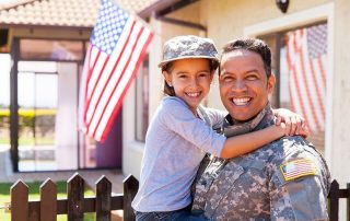 solider with his daughter