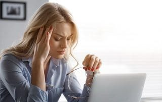 woman suffering from a headache, depression