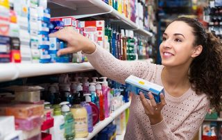 woman checking out toothpaste options