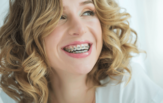 woman with traditional metal braces